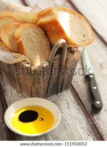 French bread baguette and olive oil. Selective focus - stock photo