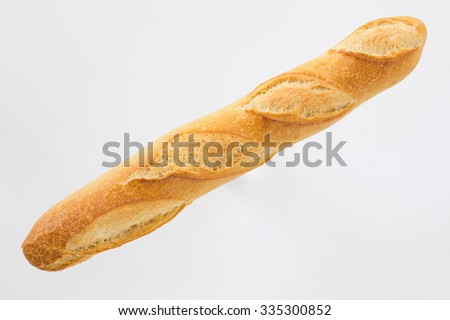 French bread baguette on a white background, made from flour. baking, top view, side view. space for text .. - stock photo