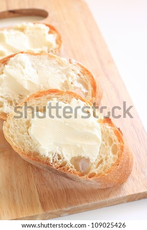 French bread, Baguette sliced on chopping board