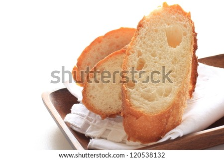 French Bread Baguette Sliced On Wooden Plate