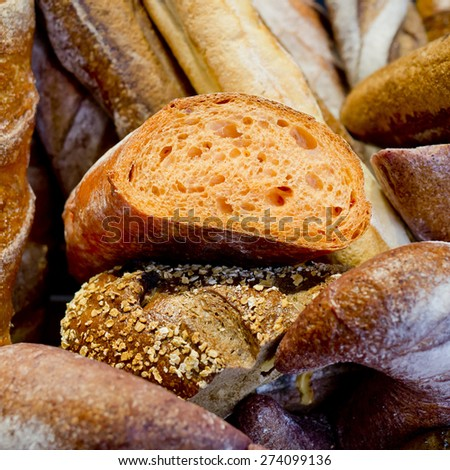 French bread baguettes in wooden box. - stock photo