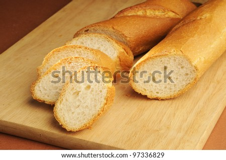 French bread ,French Bread isolated with Wood background - stock photo