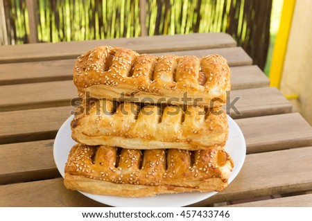 French bread hot dogs on white plate