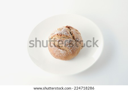 french bread on plate on white background
