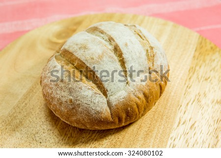 french bread on wood - stock photo