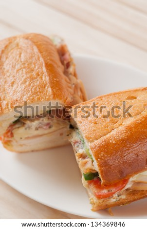 French bread sandwich with smoked chicken and bacon salad - stock photo