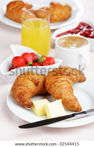 French breakfast with croissant, coffee, strawberry, and juice - stock photo