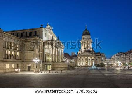 French Cathedral (Franzoesischer Dom) and Konzerthaus located on the Gendarmenmarkt in Berlin at evening, Germany, Europe - stock photo