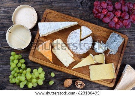 french Cheese plate served with grapes and nuts on wooden background with triangle and round wooden & French Cheese Plate Served Grapes Nuts Stock Photo (Royalty Free ...