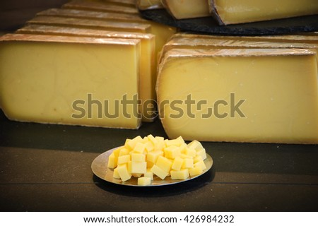 French cheese shop. Comte cheese tasting. - stock photo
