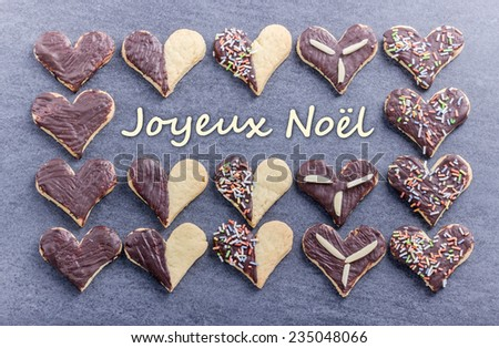 french Christmas card with Cookies and text merry christmas/merry christmas/french - stock photo