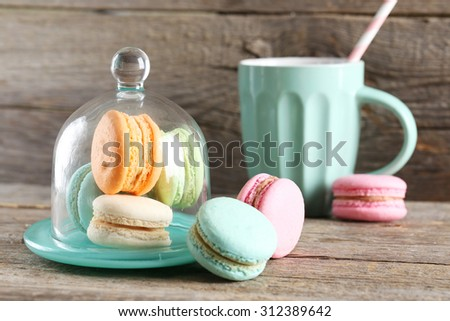 French colorful and tasty macarons on grey wooden table - stock photo