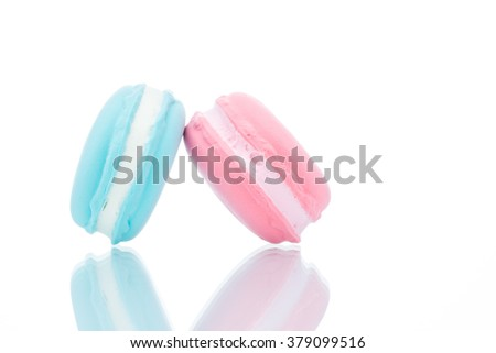 French colorful macarons stacks on white background, copy space