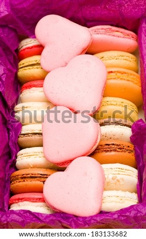 French colorful macarons with hearts - stock photo