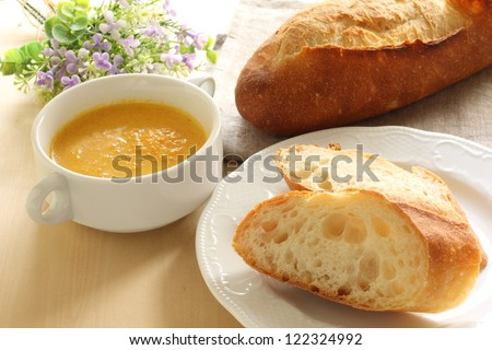 french cuisine, bread and carrot soup for gourmet breakfast image