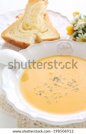 french cuisine, carrot soup and toast