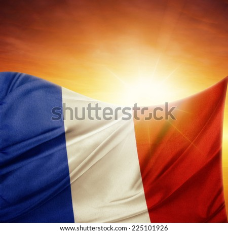 French flag in front of bright sky - stock photo