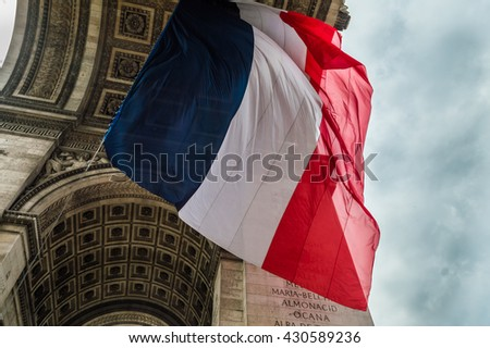 French Flag in Triumphal Arch, Paris - stock photo