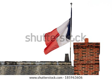 French flag on a roof in Paris