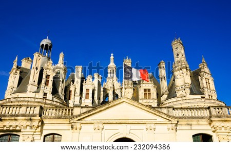 French flag on the entrance to Chateau de Chambord. (Val de Loire, France) - stock photo