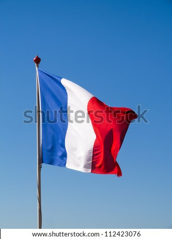 French flag pole against clear blue sky - stock photo