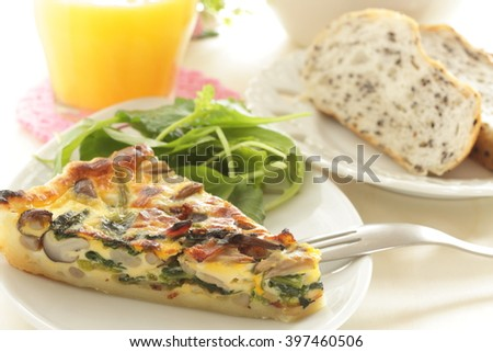 French food, mushroom  and bacon quiche - stock photo