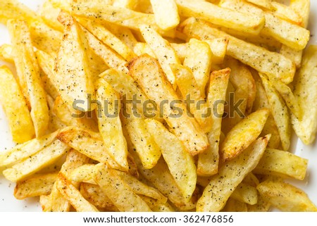 french fried potatoes on plate with pepper