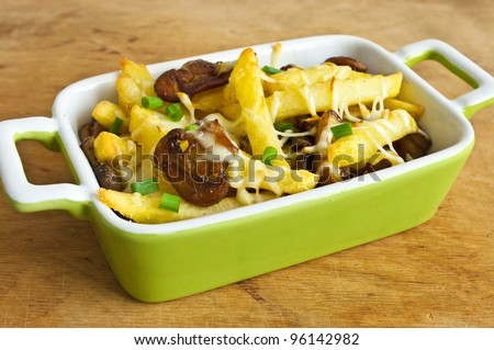 French fries casserole with champignons - stock photo