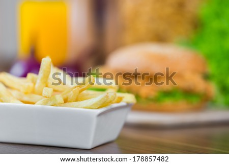 French fries chicken burger on the background - stock photo