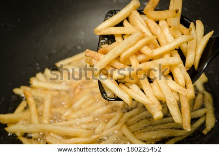 French fries in a hot pan. - stock photo