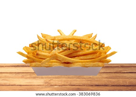 French fries in white box on table isolated on white background