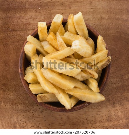 french fries on wood plate - stock photo