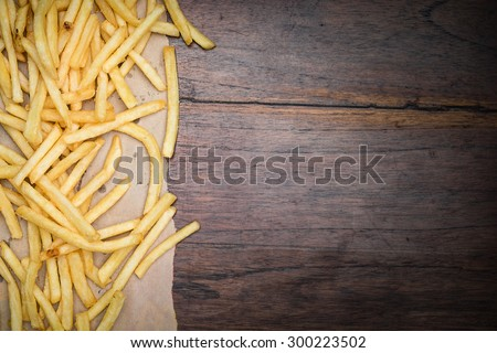 French fries on wooden desk background - stock photo
