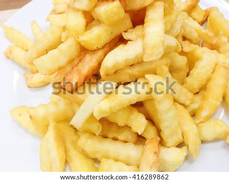French Fries served on white dish - stock photo