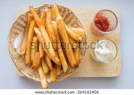 French fries with ketchup on white background. - stock photo