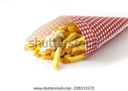 French fries with mayonnaise in red and white patterned paper bag (in Dutch called 'puntzak') isolated on white background - stock photo