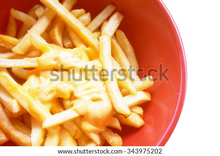 french fries with melted cheese in red bowl