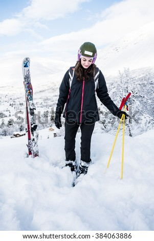 French girl with ski clothing standing in the ski centre