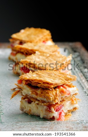 French gourmet strawberry mille feuille with whipped sour cream. Shallow dof.  - stock photo