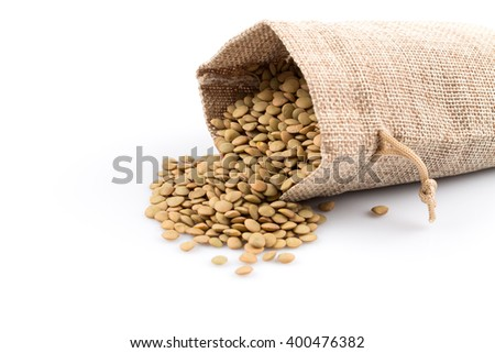French green lentils (lentilles du Puy) in a burlap bag on a white background