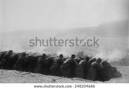 French Infantry firing from a World War 1 trench. 1914-15. - stock photo