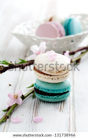French macaroons in pink, turquoise and white - stock photo