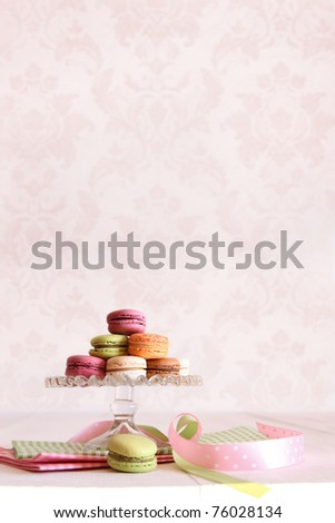 French macaroons on dessert tray with vintage feeling - stock photo