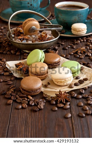 French macaroons with coffee beans and coffee cup