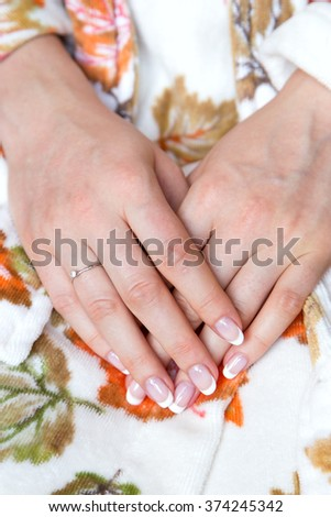 French manicure. wedding ring on the finger - stock photo