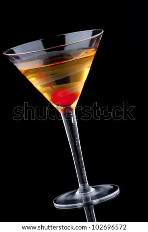 French martini in chilled glass over black background on reflection surface, garnished with maraschino cherry. Most popular cocktails series.