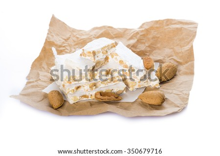 French nougat or spanish turron for christmas dessert isolated on white background
