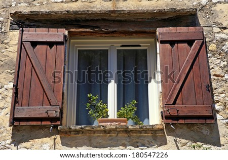 french open window with old wood shutters in stone rural house, Provence, France. - stock photo