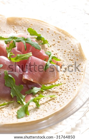 French pancake with Italian ham and ruccola