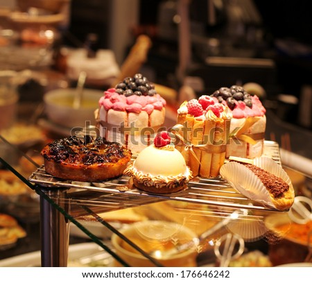 French pastries on display a confectionery shop in France - stock photo